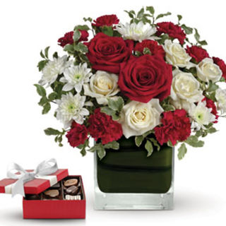 red and white roses in cube vase with choc