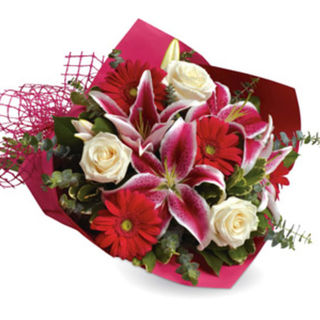 red pink white roses and lilies