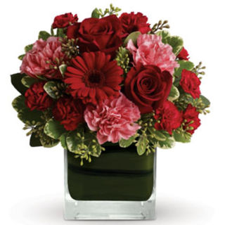 red roses red gerbs in vase